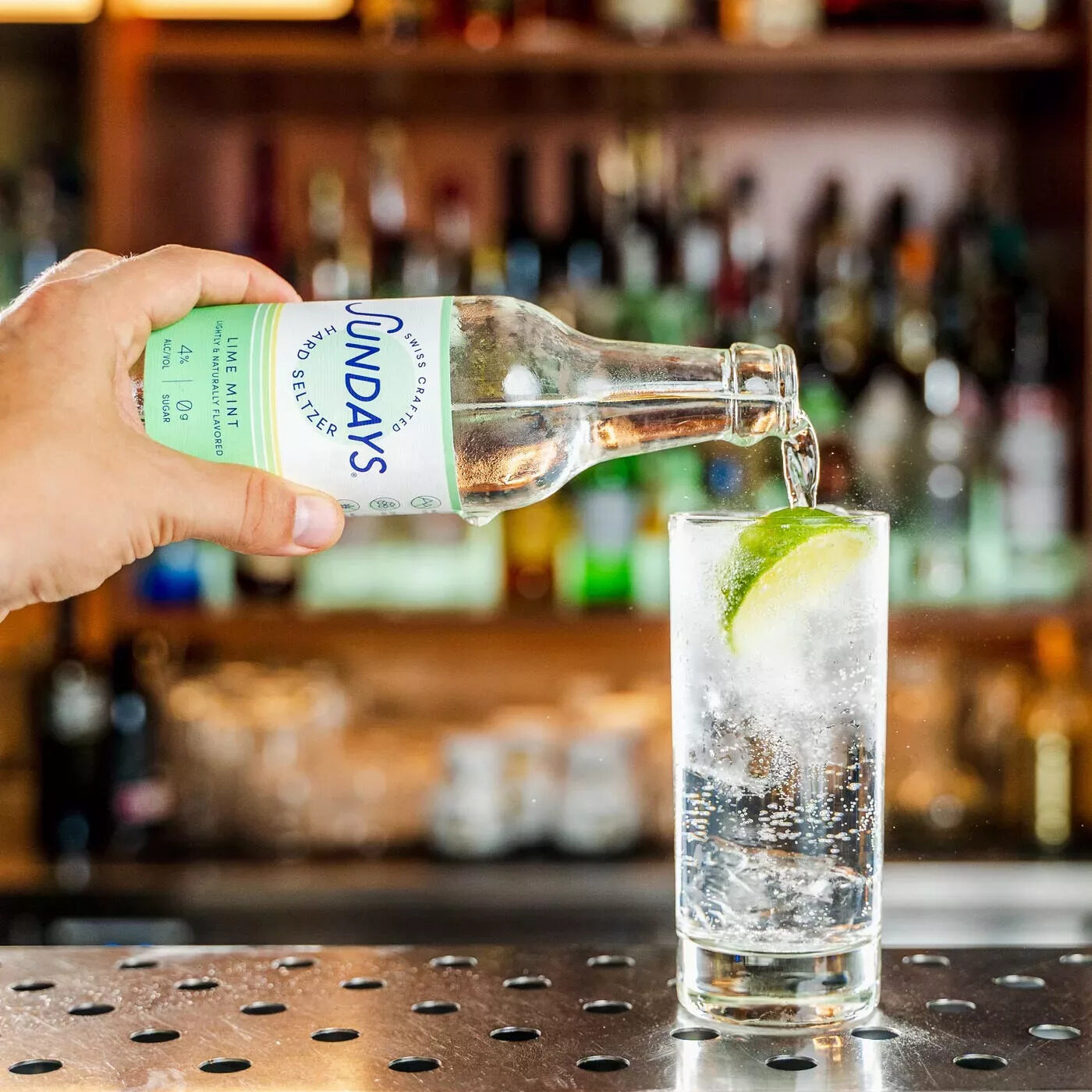 Pouring Lime Mint Hard Seltzer